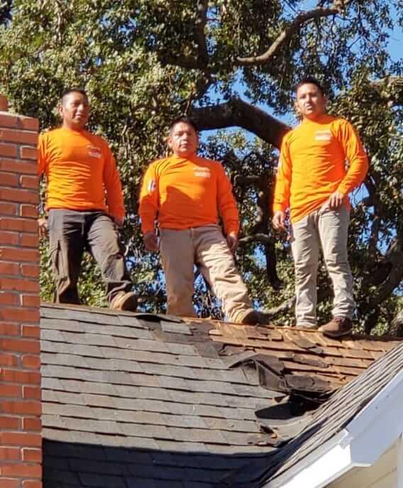 cosmic renovations and roofing team members repairing roof